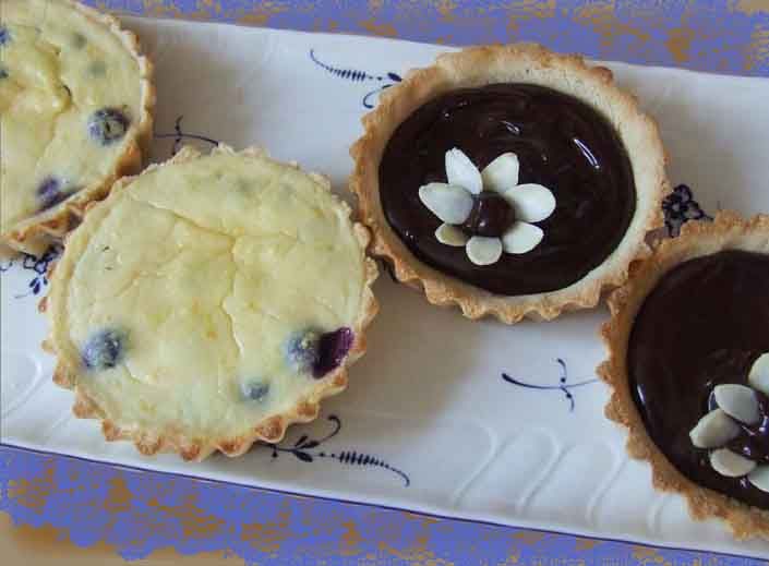 Sugar and Gluten free pastry blueberry or chocolate tarts with Stevia for tea